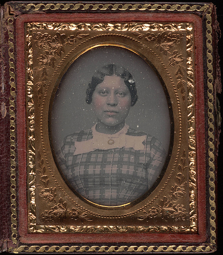 1855 photo of woman in gingam dress